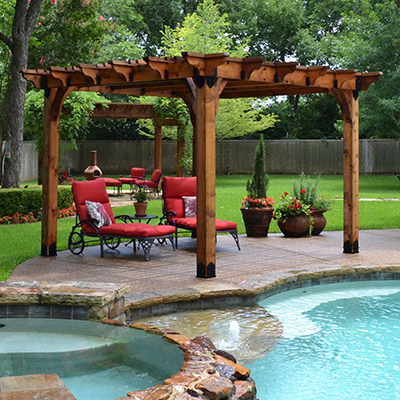 A pergola sits beside a pool for relaxation.