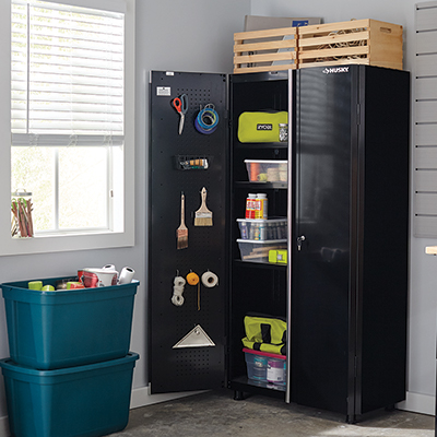 A black storage cabinet with household supplies.
