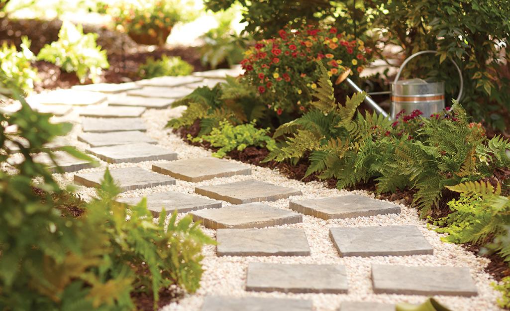 A paver garden path with pea gravel.