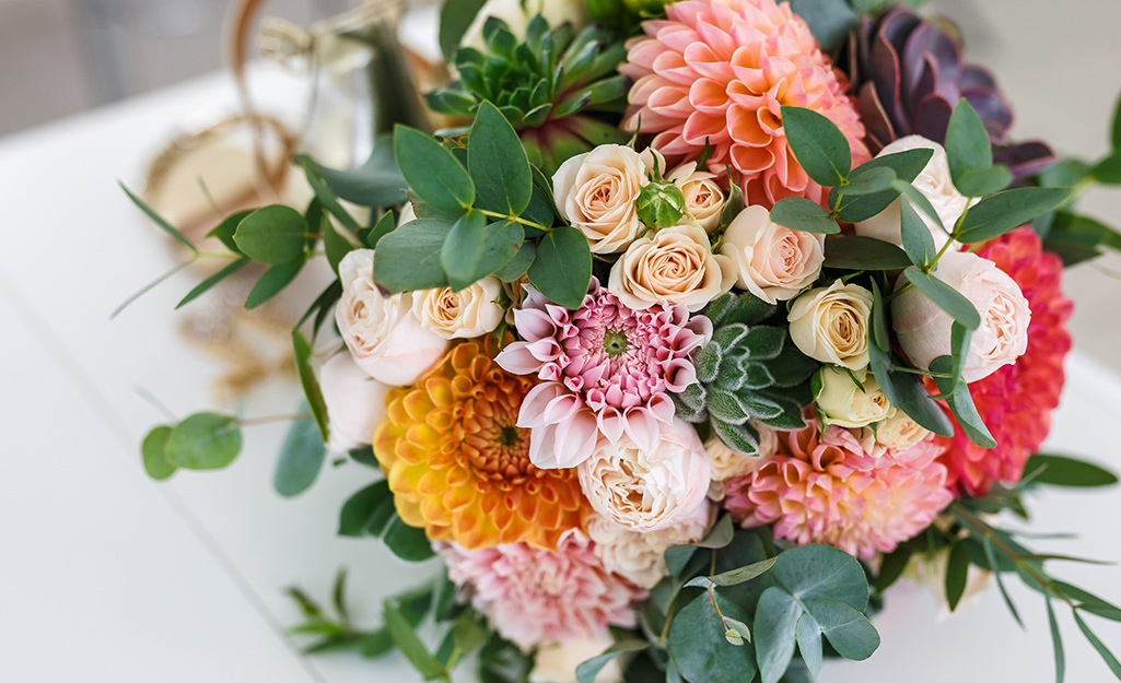 A bouquet of dahlias and greenery.