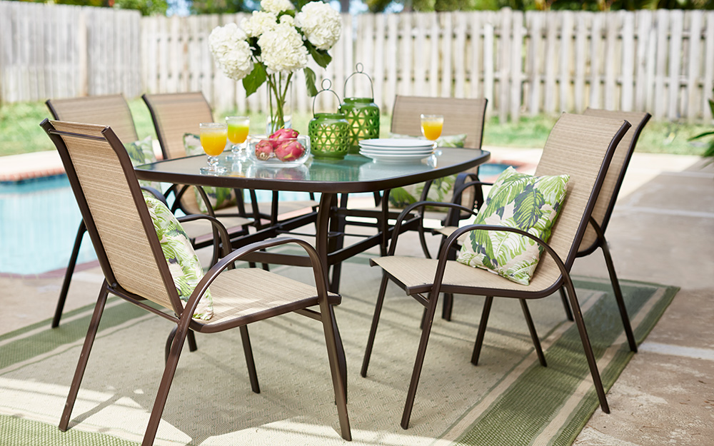 6 piece outdoor dining set next to pool