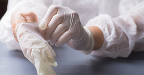 Removing disposable rubber gloves