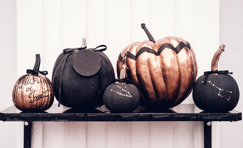 Pumpkins painted different colors.