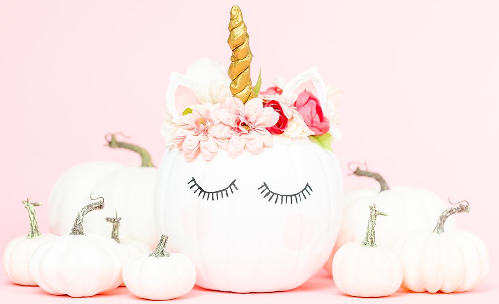 White pumpkins decorated as unicorns.