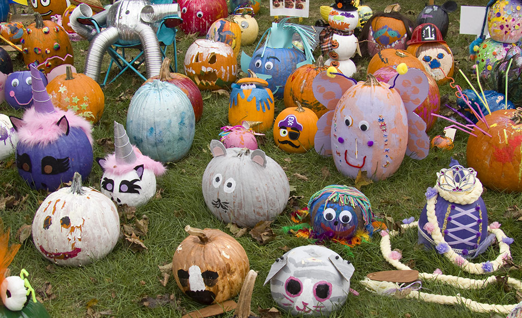 A group of painted and decorated pumpkins.