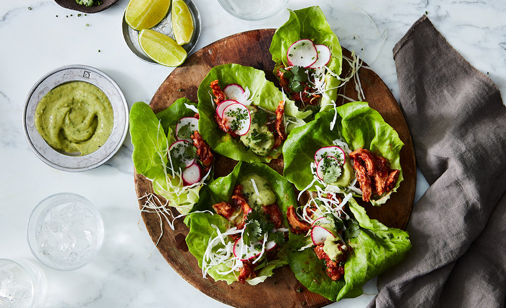 A platter with lettuce wraps
