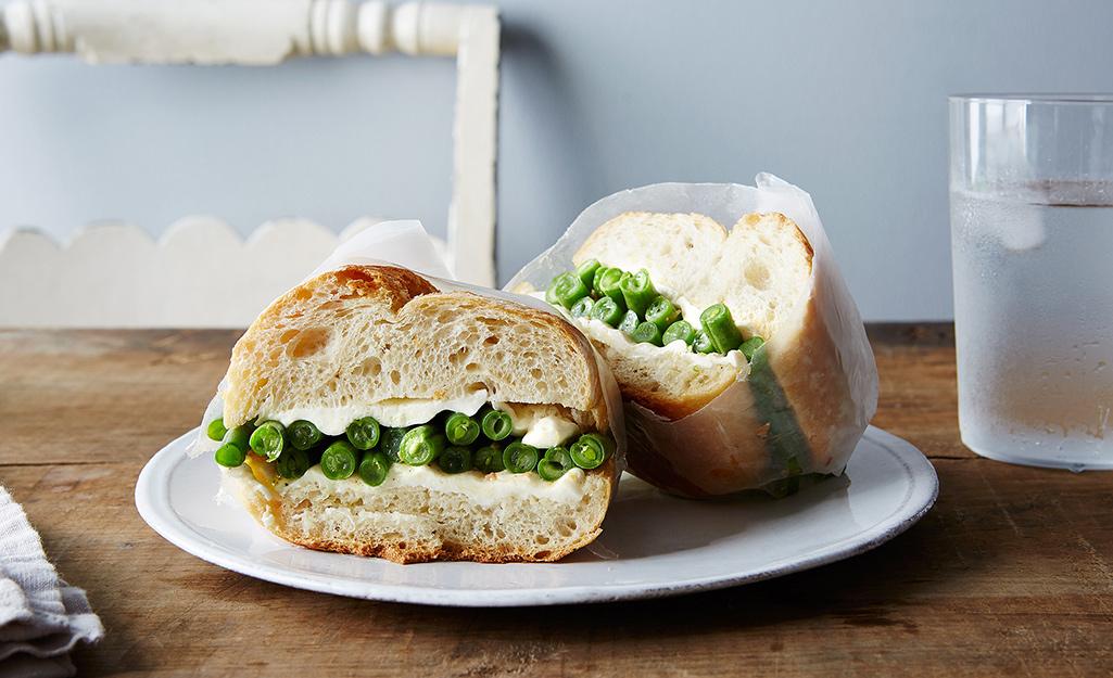 A green bean sandwich on a plate