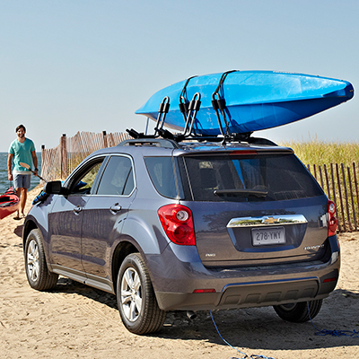 an SUV with a roof rack holding a kayak