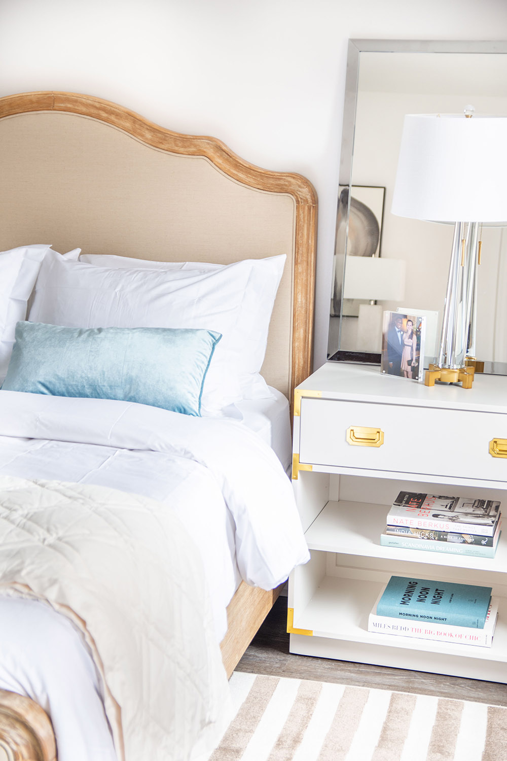 A bedroom scene with a bed and nightstand.