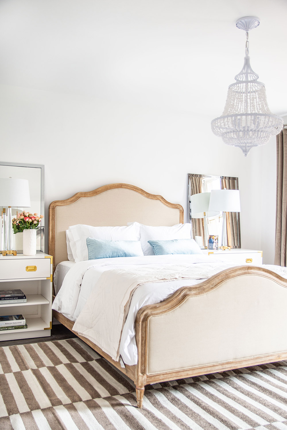 A bedroom decorated with blue, grey and metallic details.