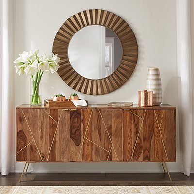 A wood buffet with gold inlay and copper tones.