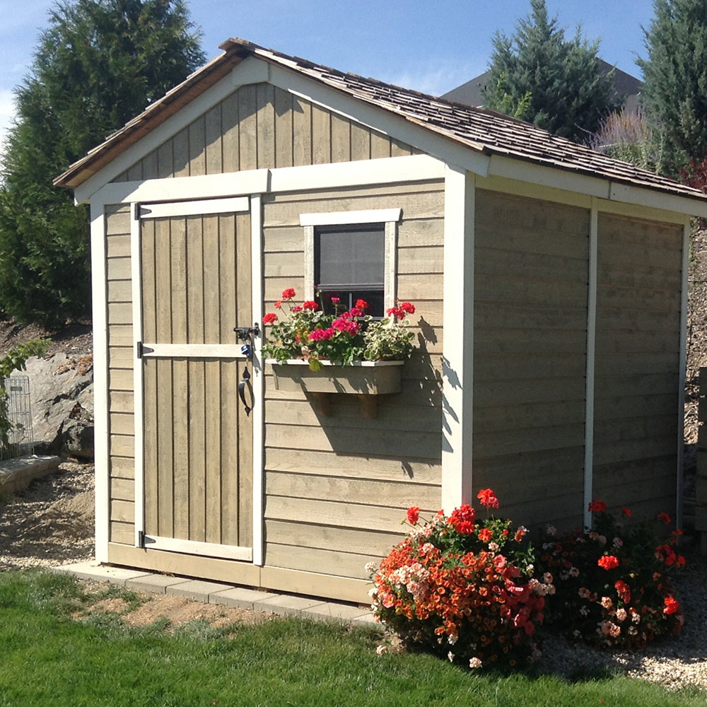 Storage shed with flowers in front