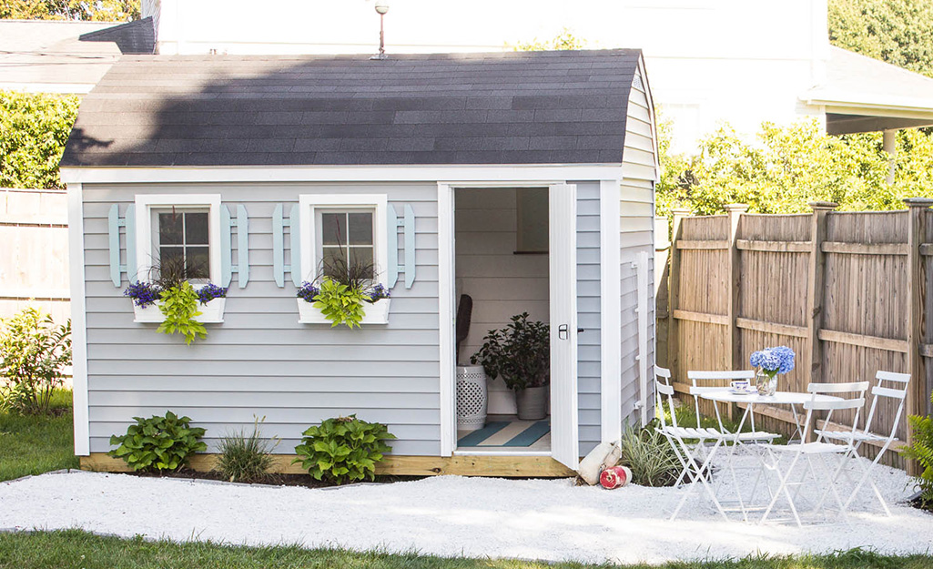 Shed with a patio and furniture