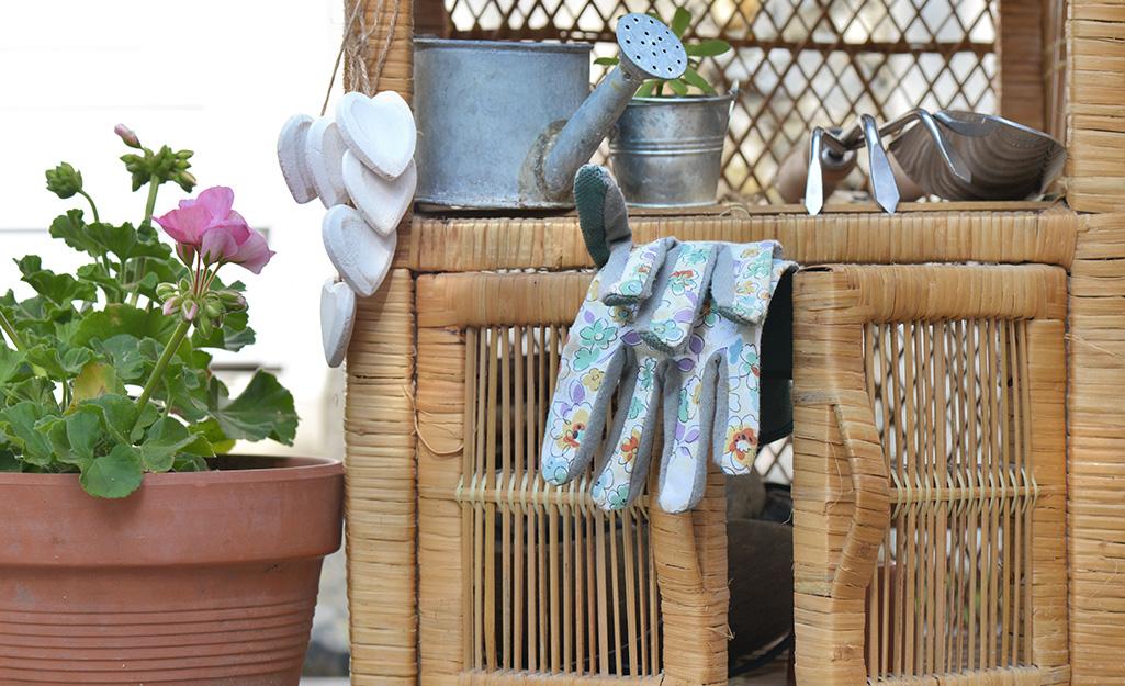 Storage cabinet with gardening gloves