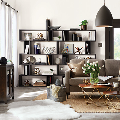 Black decorator shelves line the walls of a living room.