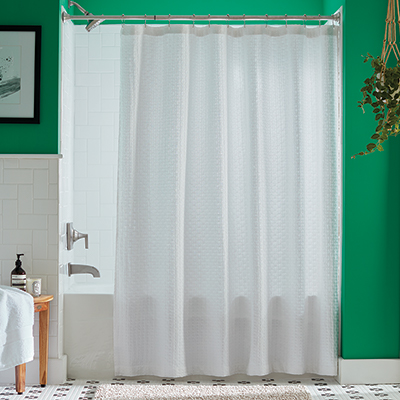 A shower curtain hanging over a bathtub