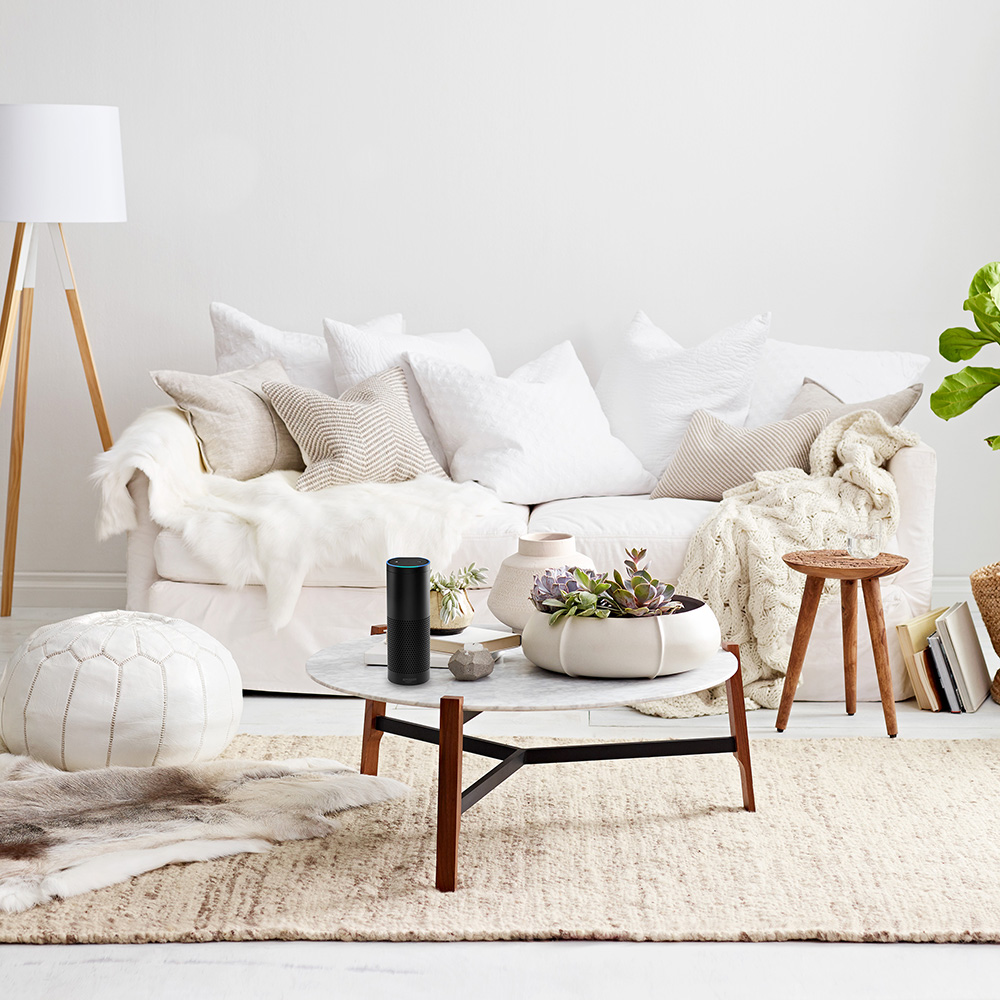 A living room with a white sofa and accessories.