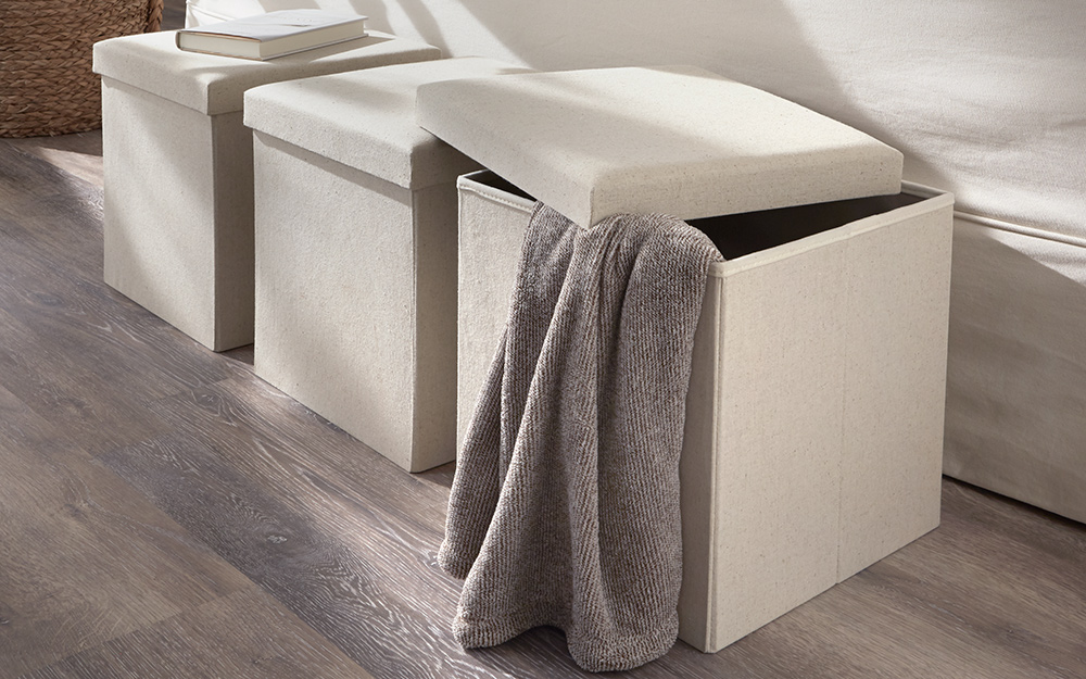 Beige ottomans with removable tops.