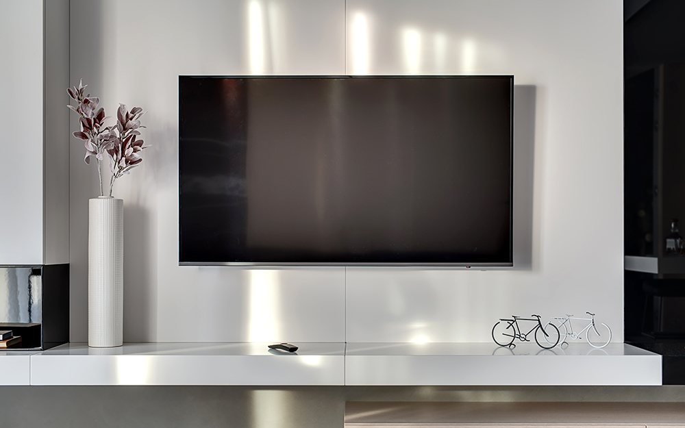 A flat screen television mounted on a wall.