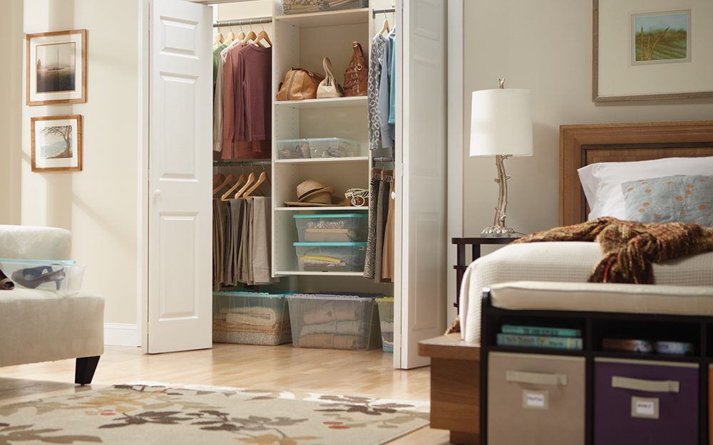 A bedroom with an open closet.