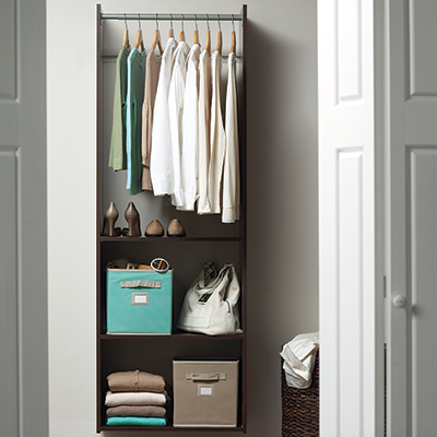 A small closet with organized storage