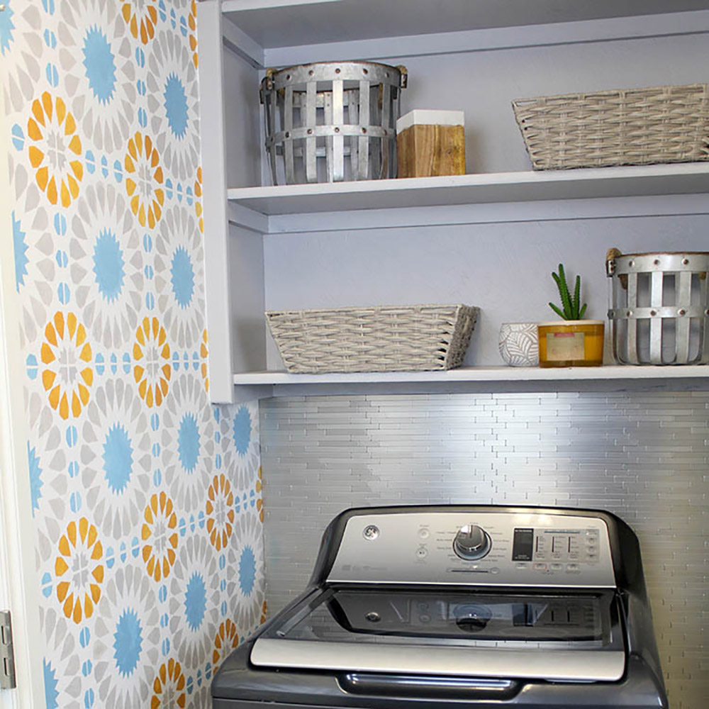 A small laundry room with an accent wall.