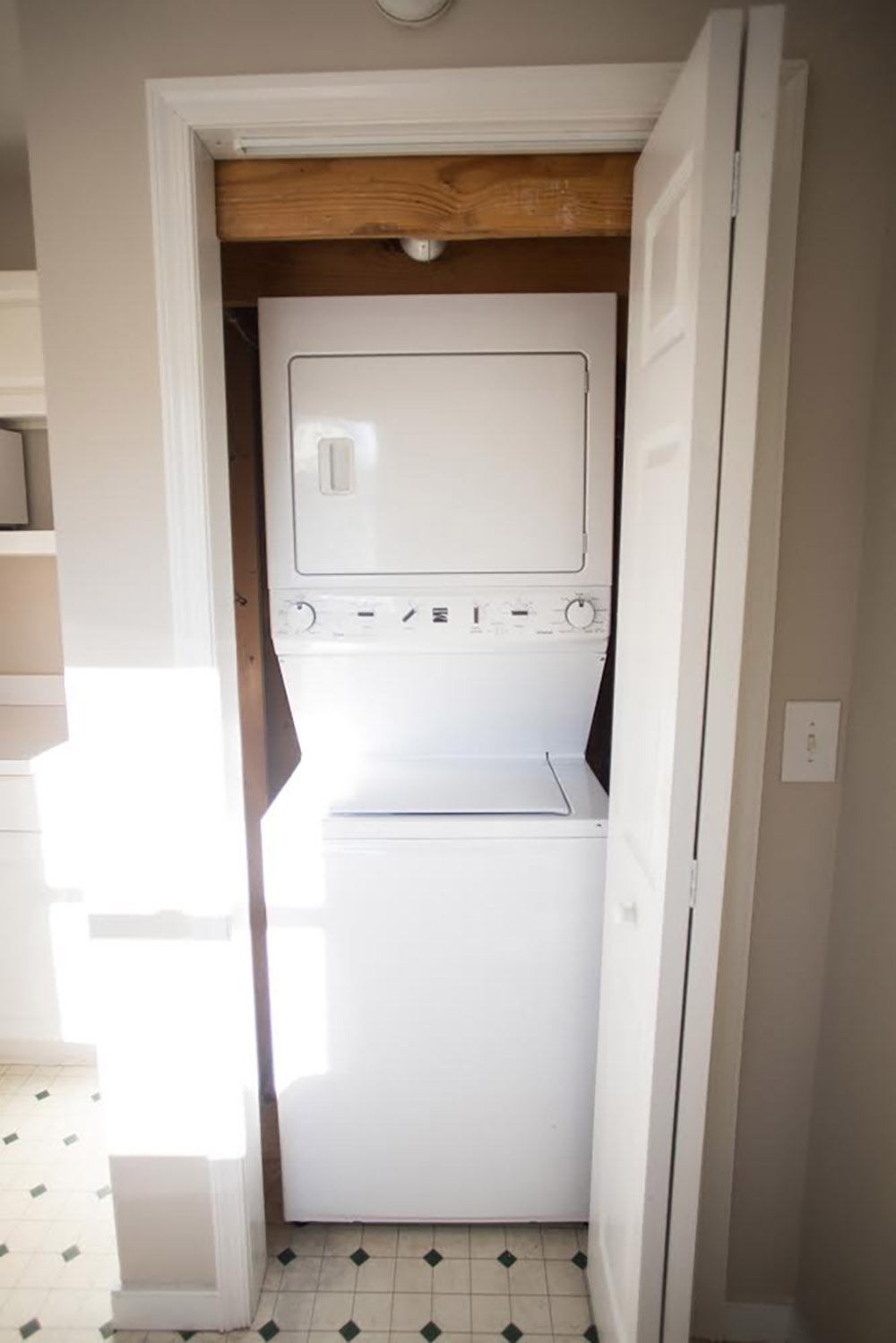 A closet with a white washer and dryer.