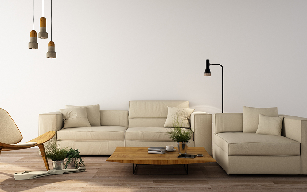 The low height of warm gray sectionals make a living room look bigger.
