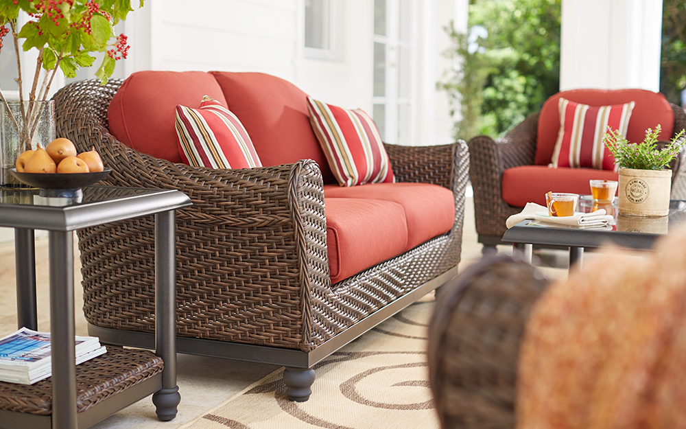 a small patio featuring a loveseat and coffee table