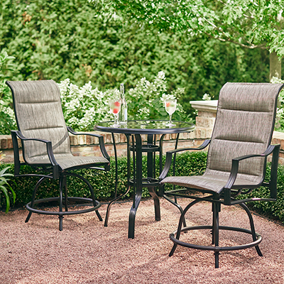 a small patio featuring a 3 piece bistro set