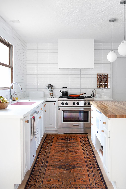A bright white kitchen with KitchenAid appliances.