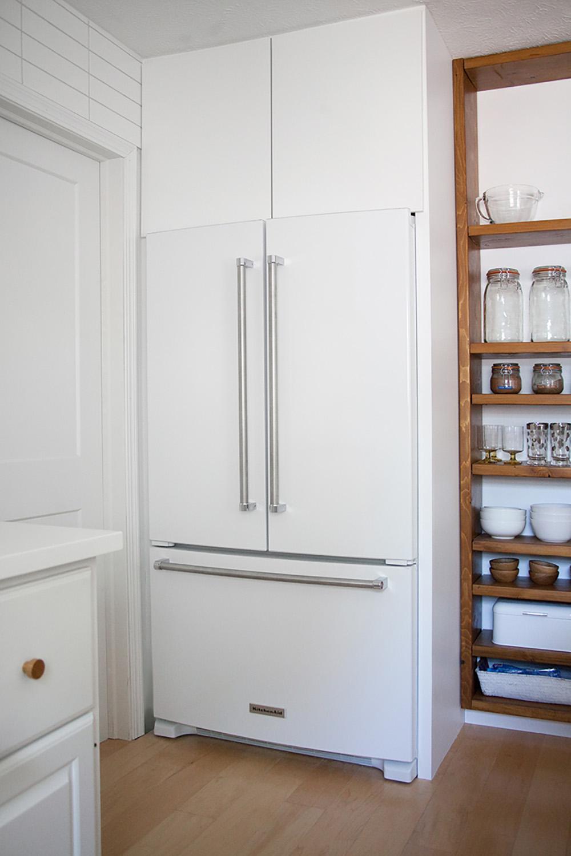 A white KitchenAid refrigerator.