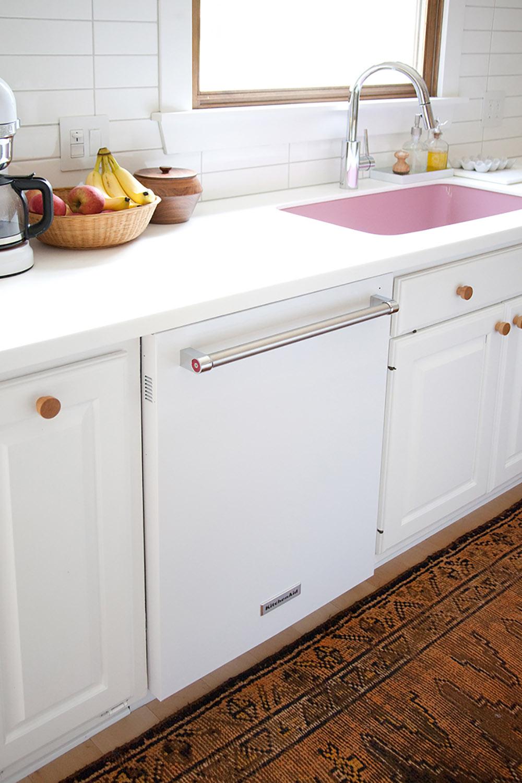 A white KitchenAid dishwasher.