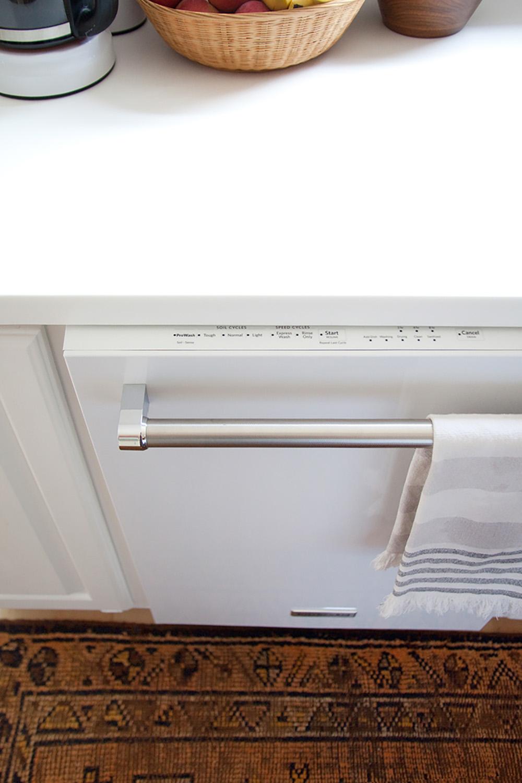 The top control panel on a white KitchenAid dishwasher.