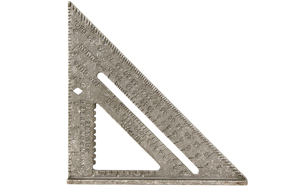 A metal speed square, a triangle-shaped tool to measure angles, is seen on a white background.