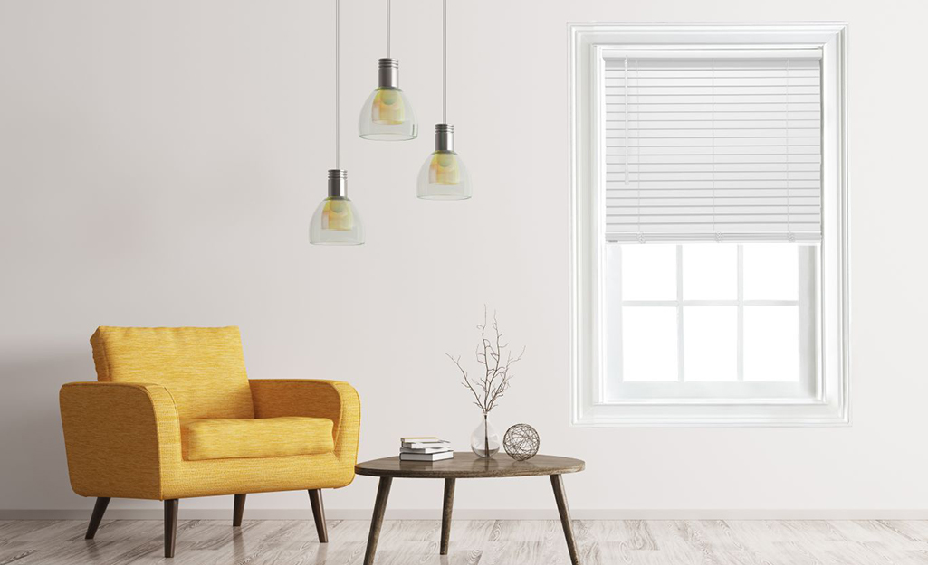 White cordless blinds cover a window in a contemporary room with a retro yellow chair and side table.