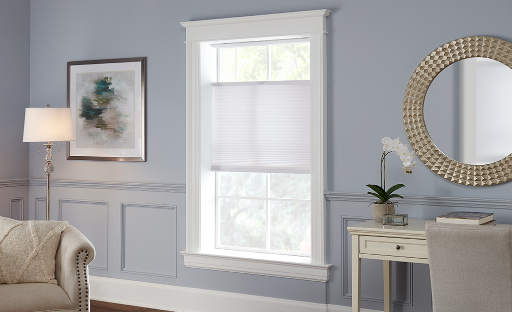 Top down bottom up blinds are shown open at the bottom and the top of the window.