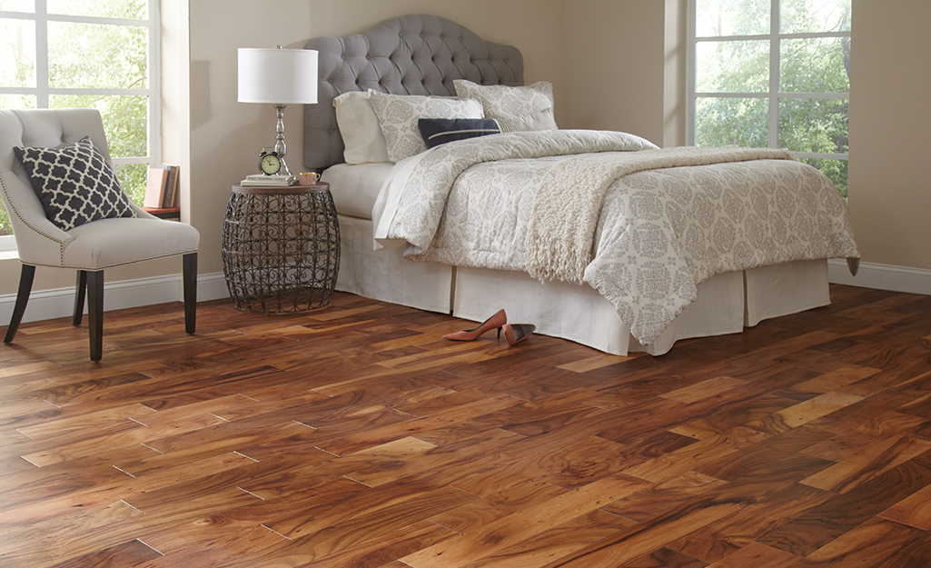 Dark hardwood flooring installed in a bedroom.