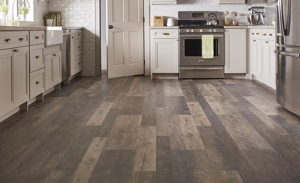 Vinyl flooring in shades of gray installed in a kitchen.