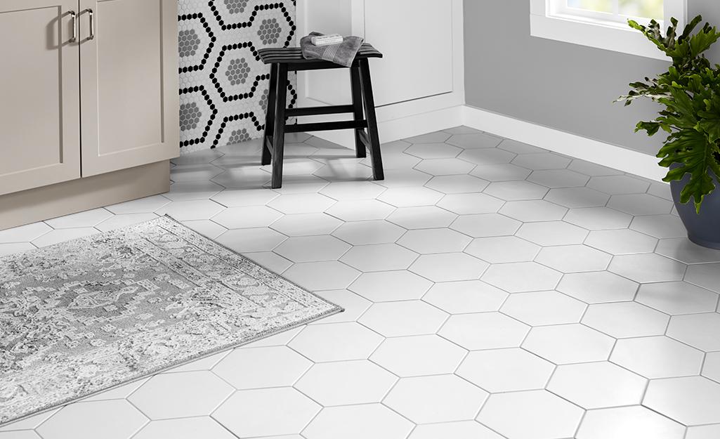 White porcelain tile flooring installed in a bathroom.