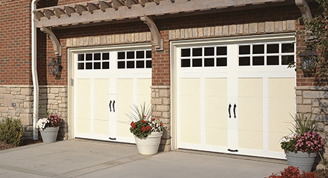 the front of a house showing a traditional garage door