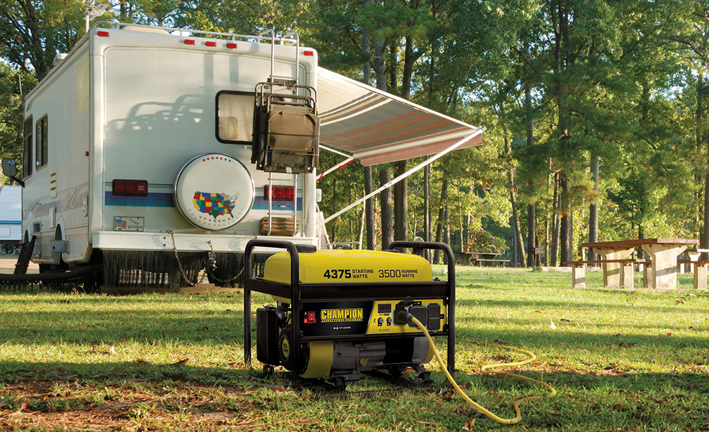 An inverter generator powering an RV in a park.