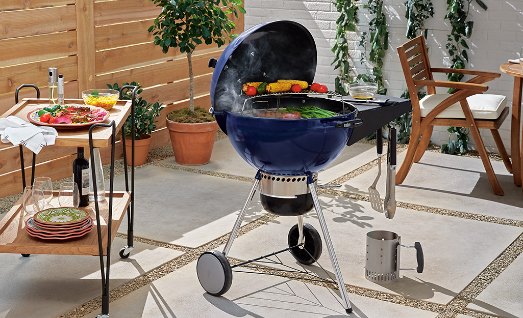 Food gilling on a charcoal kettle grill.