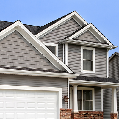 Grey gable roof home with k-style gutters.
