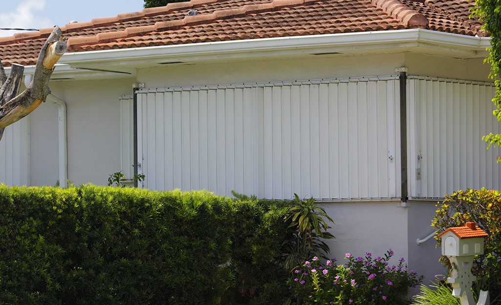 Hurricane shutters installed on a home's windows.