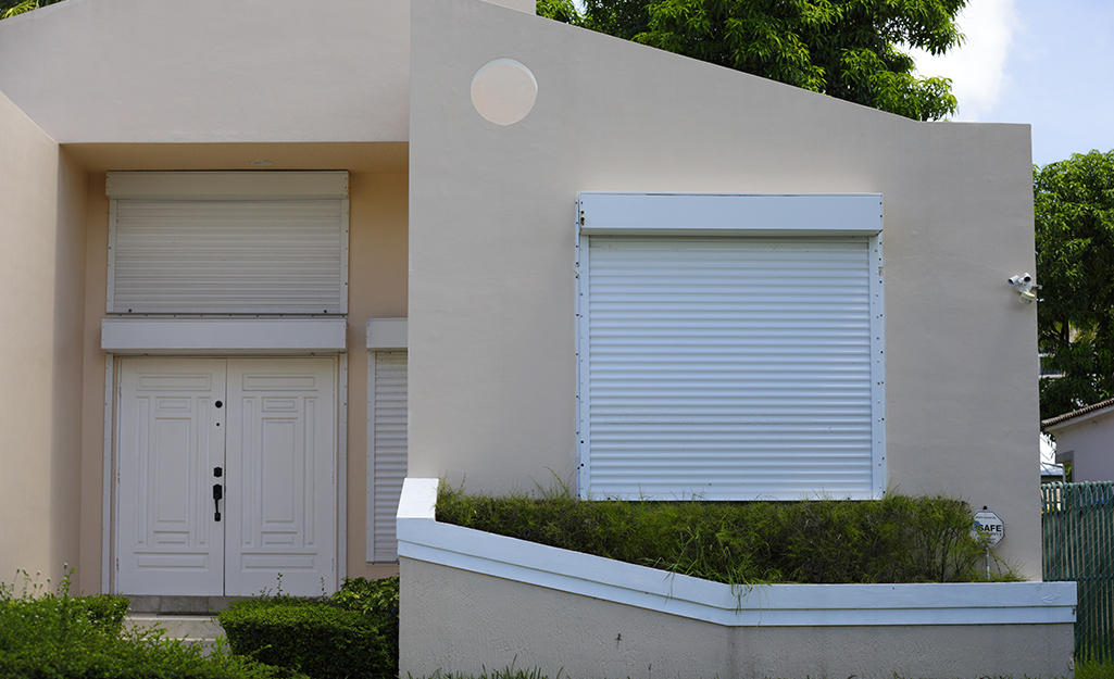 Roll down shutters installed on a home's front windows.