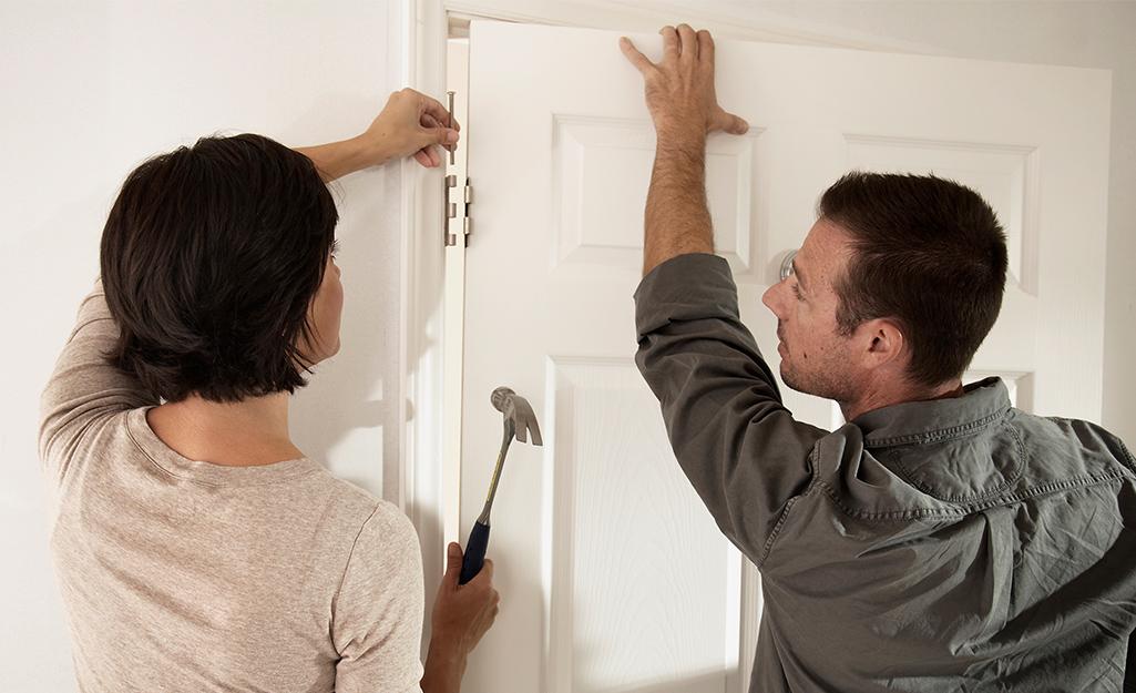 People installing a door.