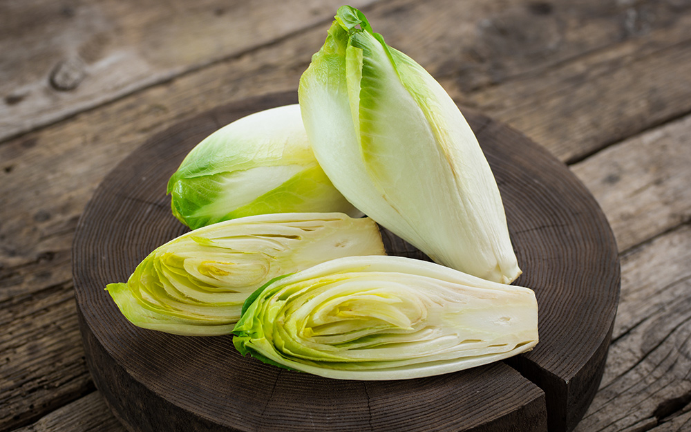 A plate of sliced endive on a table.