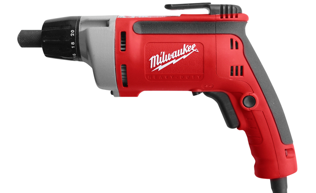A power drill with a clutch screwdriver tip.
