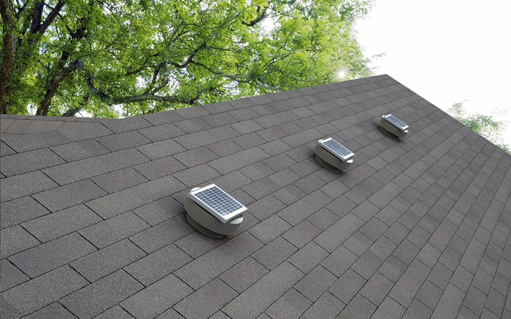 Box roof vents on the top of a house.